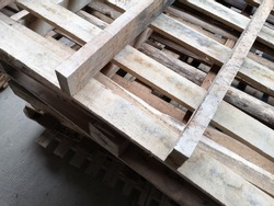 Wooden pallet crates stacked together in cargo area