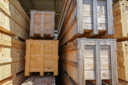Wooden pallets for shipping stacked in industrial warehouse