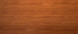 Wooden panel background texture with a decorative red woodgrain pattern for use in carpentry, interior decor and building