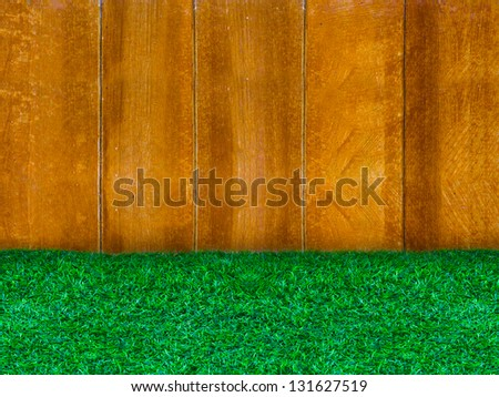 Wooden panel with green grass for background