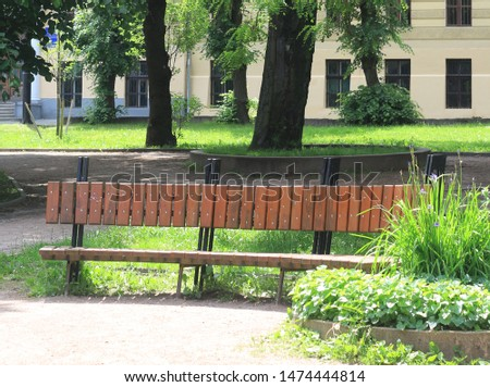Wooden park bench, nobody, lonely