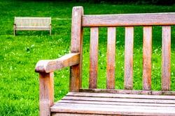 wooden parkbench at a park
