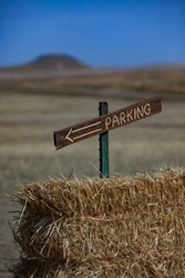 Wooden Parking Sign in Haybail Open Space