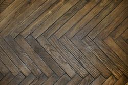 Wooden parquet top view. Herringbone natural parquet