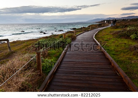 Wooden path along side the sea at sunset, California