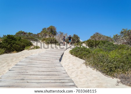 Wooden path at Chrissi island. White sand