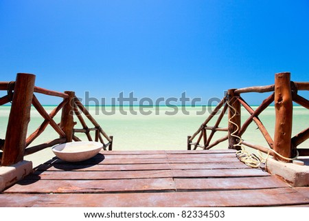 Wooden path leading to beautiful ocean