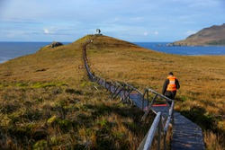 Wooden path leading towards the Cape Horn Memorial Sculpture on Cape Horn Island, the southernmost point of South America in Chile
