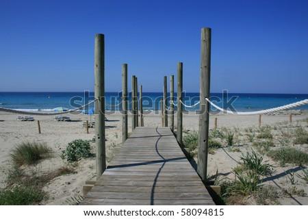 Wooden path onto beach, Spain #58094815
