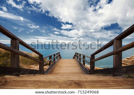 Wooden pathway built on a rocky coast