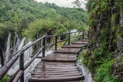 Wooden pathway near big waterfall, Plitvice Lakes National Park, Croatia