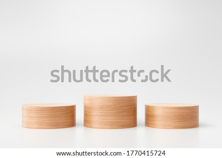 Wooden pedestal or product display on white background with presentation concept. Wood podium stage. 3D rendering. Сток-фото ©