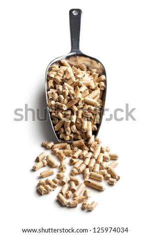 Wooden pellets -bio fuel on scoop.