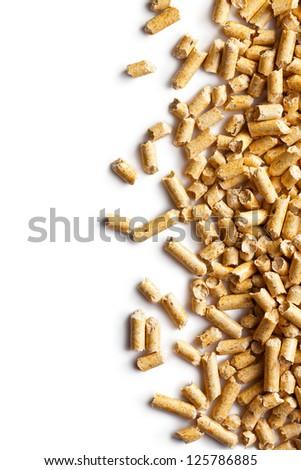 Wooden pellets -bio fuel on white background.