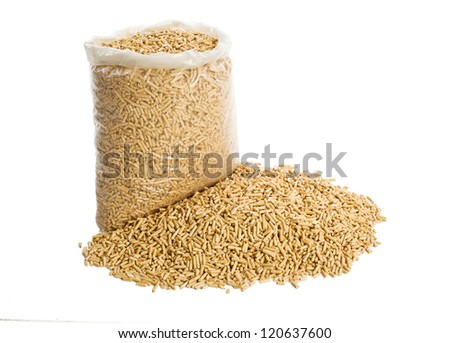 wooden pellets in plastic bag on white background