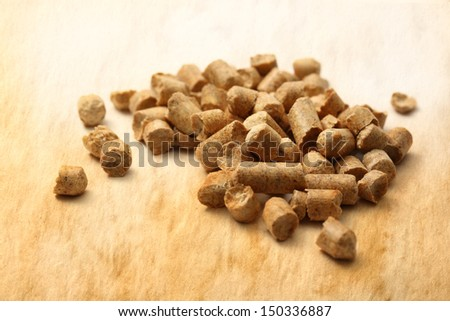 Wooden pellets on paper background