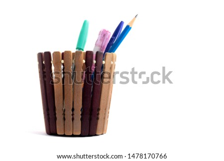 Wooden pen holder with pencils and pens on a white background #1478170766