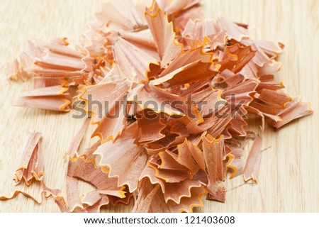 wooden pencil shavings on white paper background
