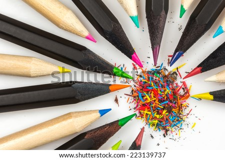 Wooden pencils of different colors and color chips