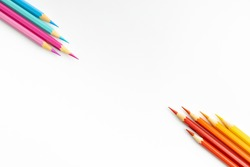 Wooden pencils of different colours as banner concept of work from home with copy space for runaround or wraparound text.WFH concept.