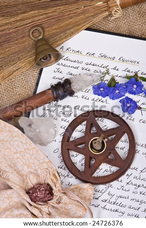 wooden pentacle with incense burning with hand written book of shadows and flowers - spring equinox ritual