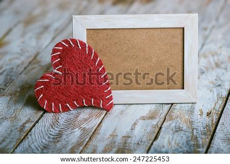 wooden photo frame with Valentine's symbol