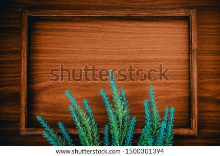 Wooden picture frame and a bunch of blue lavender. Horizontal spring greeting card with copy space in the centre