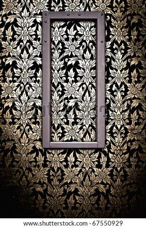 Wooden picture frame on Thai traditional pattern wall for decoration