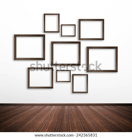 Wooden picture frames on white wall inside the room