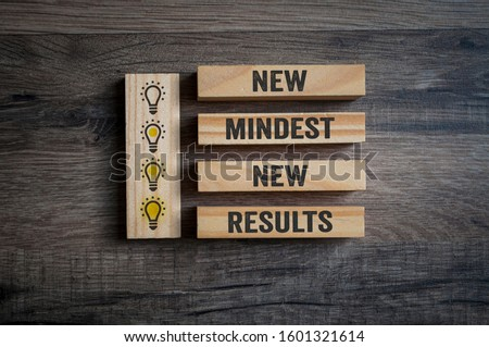 Wooden pieces on a wooden background showing the words new mindset and new results Stock photo ©