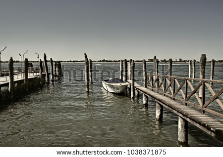 wooden pier and boat docks on...