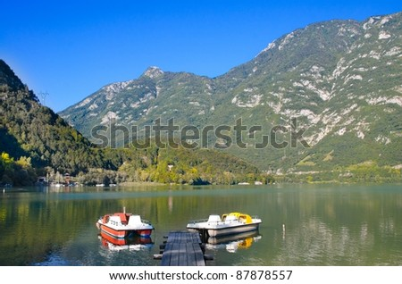 Wooden pier and boats on a lake in Italy