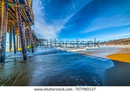 Wooden pier in Pismo beach seen from the foreshore. California, USA Zdjęcia stock ©