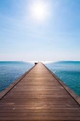 Wooden pier in the blue sea on Samui island, Thailand.