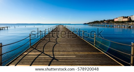Wooden pier in touristic resort Portoroz - Slovenia. Travel, Vacation, Summer and Holiday concept. #578920048