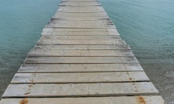 Wooden pier next to the Mediterranean sea on the island of Ibiza in Spain, holiday and summer scene
