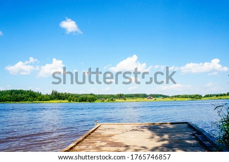Wooden pier on a lake scene, horizontal view with a beautiful rustic background