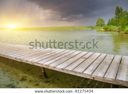 Wooden pier on beautiful lake.Nature composition.