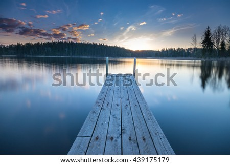 Wooden pier on the lake. Beautiful landscape