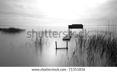 Wooden pier on the lake,black and white photo