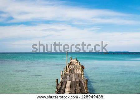 wooden pier on the paradise beach in Thailand