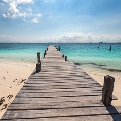 Wooden pier on tropical beach, Mexico, Cancun