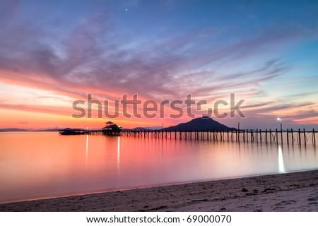 wooden pier on tropical Kanawa Island at dusk