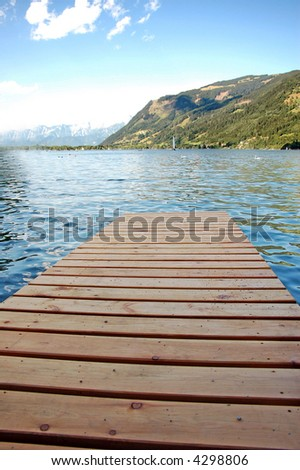 wooden pier over mountains lake