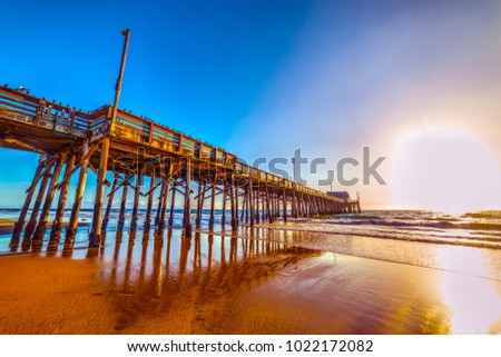 Wooden pier under a clear sky in Newport Beach. California, USA