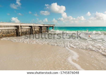 Wooden pier with blue sea and blue sky on background. stock photo
