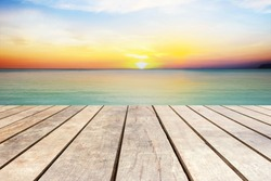 Wooden pier with sea at sunset time