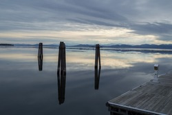 Wooden Pillars Reflecting in Lake Champlain in Burlington, Vermont, USA
