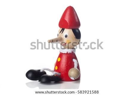Wooden Pinocchio doll isolated on white background.