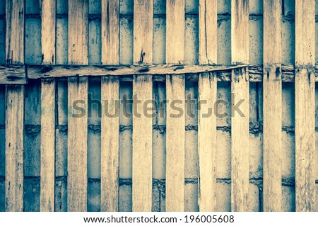 wooden plank over cement wall - texture  cracks cement background ancient stone retro